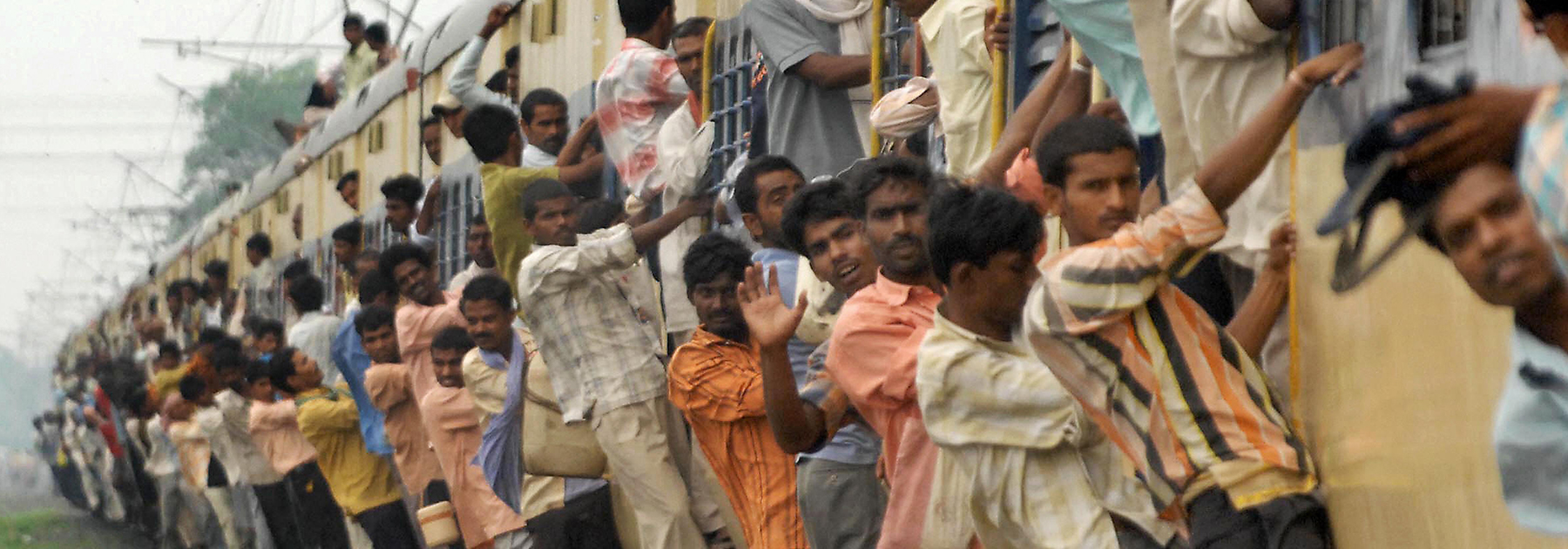 Commuters overcrowd a local passenger train on the Patna-Gaya railway track in Patna. (STR/AFP/Getty Images)