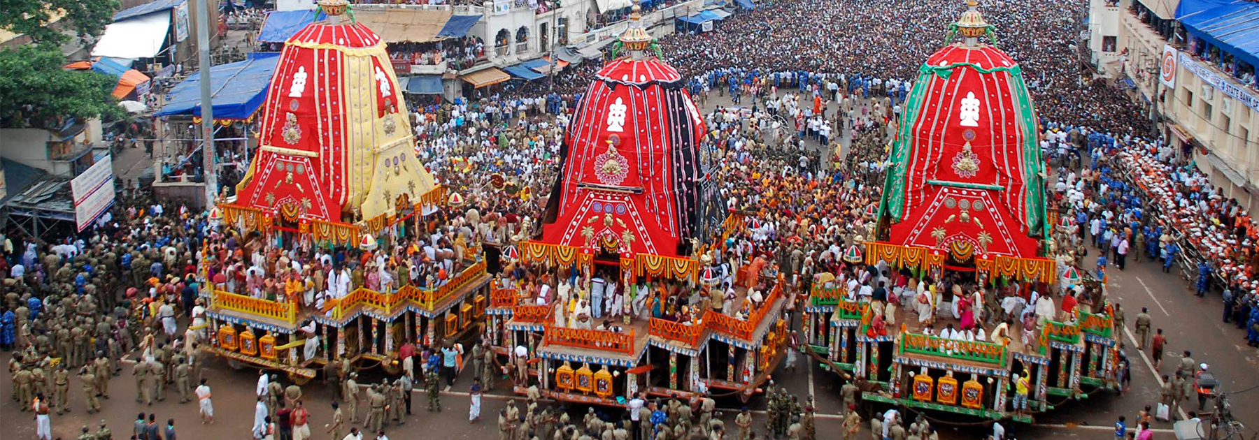 Hindu devotees gather as three giant chariots are pulled during the Rath Yatra of Lord Jagannath in Puri. (STR/AFP/GettyImages)