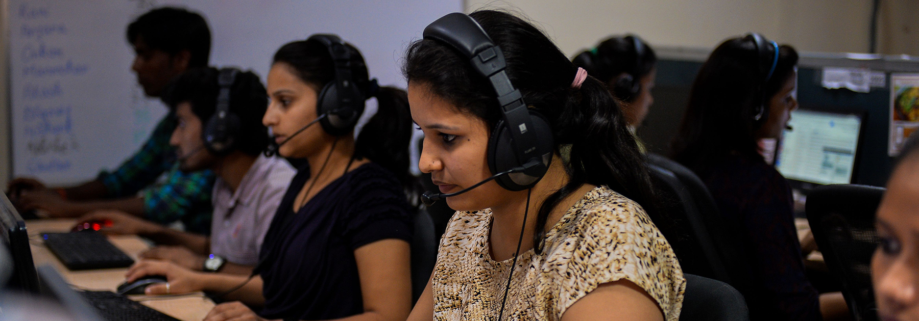 A woman works at a call center of TravelKhana, India's vast railway network, in Noida. (CHANDAN KHANNA/AFP/Getty Images)